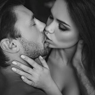 Image of a woman and a man passionately locked in a kiss